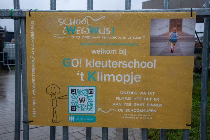 Aan de schoolpoorten vind je een QR-code met info over de school.