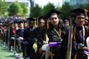Studenten van The City College of New York wachten op hun diploma-uitreiking.