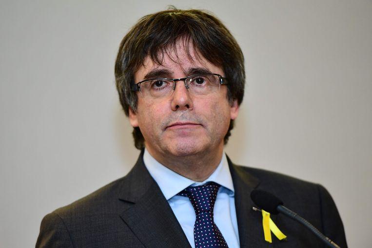 Het Openbaar Ministerie heeft volgens Catalaanse media een onderzoek geopend naar de praktijken van de Spaanse politie tegen de Catalaanse leider Carles Puigdemont. Beeld AFP