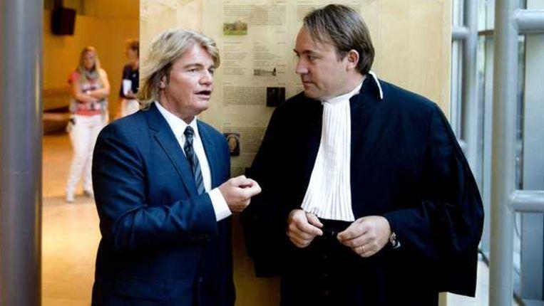 Rob Bolland (L) en zijn advocaat Geertjan van Oosten. Beeld anp
