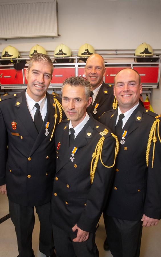 Lintjes voor brandweermannen in Megen. Van links naar rechts: Wilfred Witsiers, Peter Bekker,Rob Schoenmakers en Ferry Witsiers. Fotograaf: Van Assendelft/Jeroen Appels