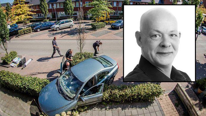 De auto met kogelgaten in de voorruit en een verbrijzelde zijruit. kader: slachtoffer Robert Voorhorst