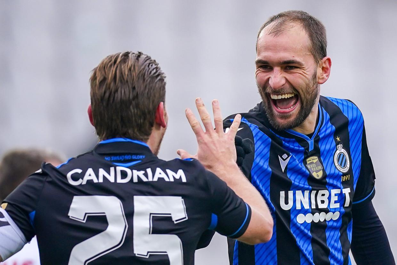 Ruud Vormer (l.) en Bas Dost, die zich de voorbije weken al een aanwinst toonde voor kampioen Club Brugge. Beeld Photo News