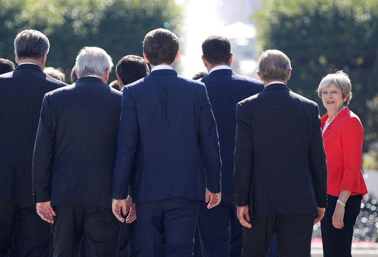 De Britse premier Theresa May arriveert op 20 september in het Oostenrijkse Salzburg voor een groepsfoto met de EU-leiders.   Beeld Lisi Niesner