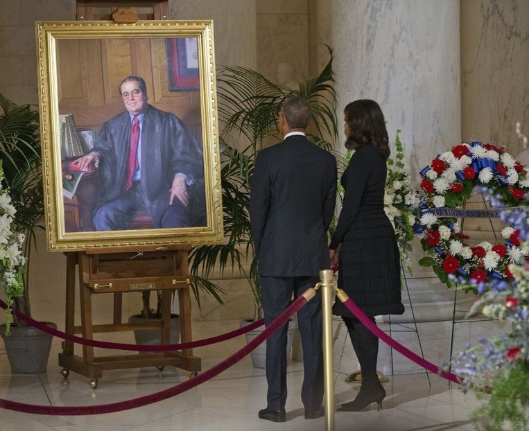 Barack en Michelle Obama op de begrafenis van rechter Antonin Scalia. Beeld ap