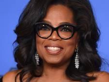 Oprah als een kind zo blij met haar eigen Barbiepop