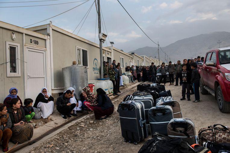 Een kamp in Dohuk, Irak, voor jezidi-vluchtelingen. Sommigen staan op het punt te vertrekken voor hervestiging in Duitsland. Beeld NYT