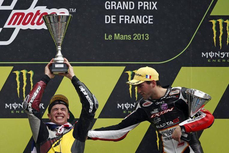 Xavier Siméon (r) feliciteert de winnaar Beeld REUTERS
