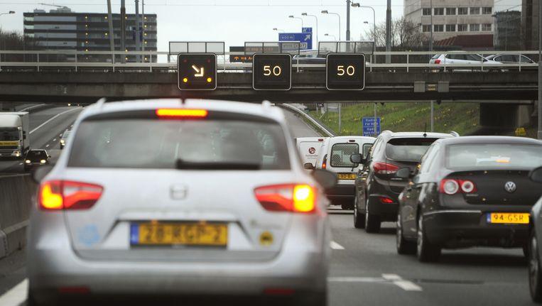 Google verwacht dat het aantal files in en rond de stad kan worden teruggedrongen Beeld ANP