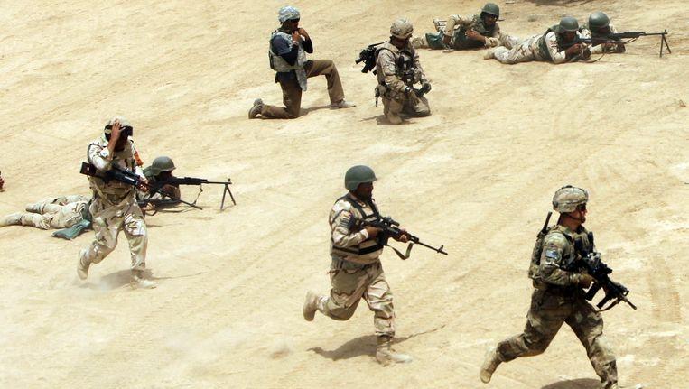 Een training van Iraakse militairen. Beeld afp
