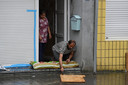 Illustration shows a man with sand bags at his door as floods in Liege after heavy rainfall, Thursday 15 July 2021. The provincial disaster plan has been declared in Liege, Luxembourg and Namur provinces after large amounts of rainfall. Water in several rivers has reached alarming levels. BELGA PHOTO ERIC LALMAND