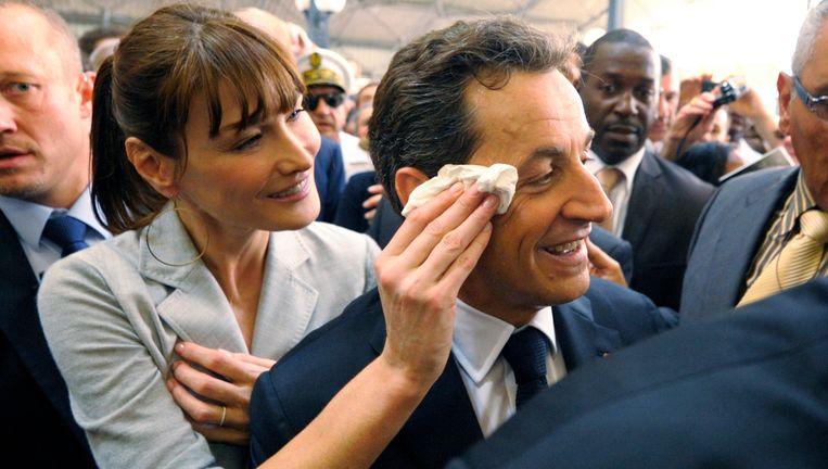 Carla Bruni en de Franse president Nicolas Sarkozy. Foto Beeld reuters