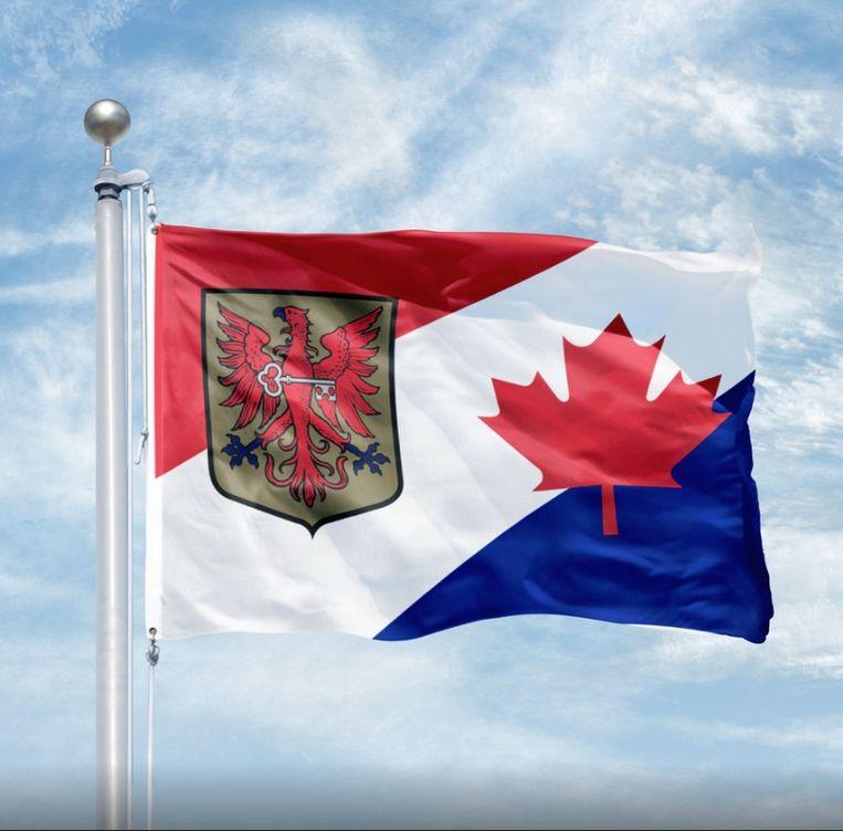 De speciale bevrijdingsvlag van Apeldoorn: rood, wit, blauwe diagonalen, met het wapen van Apeldoorn en de Canadese 'maple leaf'.  Beeld ANP