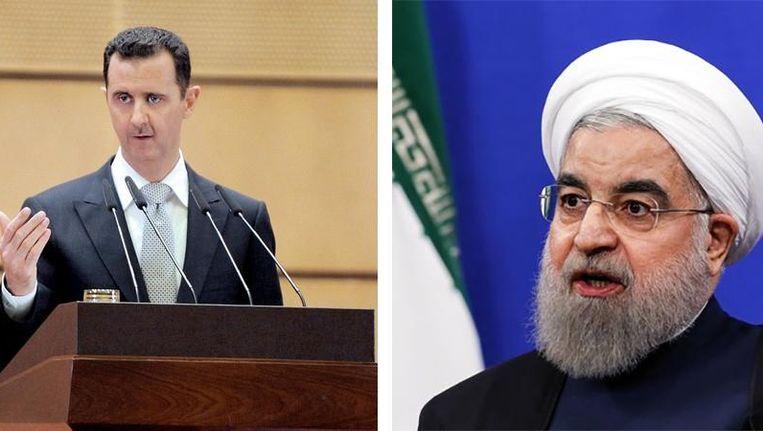 De Syrische president Bashar al-Assad en de Iraanse president Hassan Rohani. Beeld reuters
