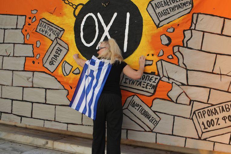 Een anti-besparingsdemonstrante in Athene. Beeld GETTY