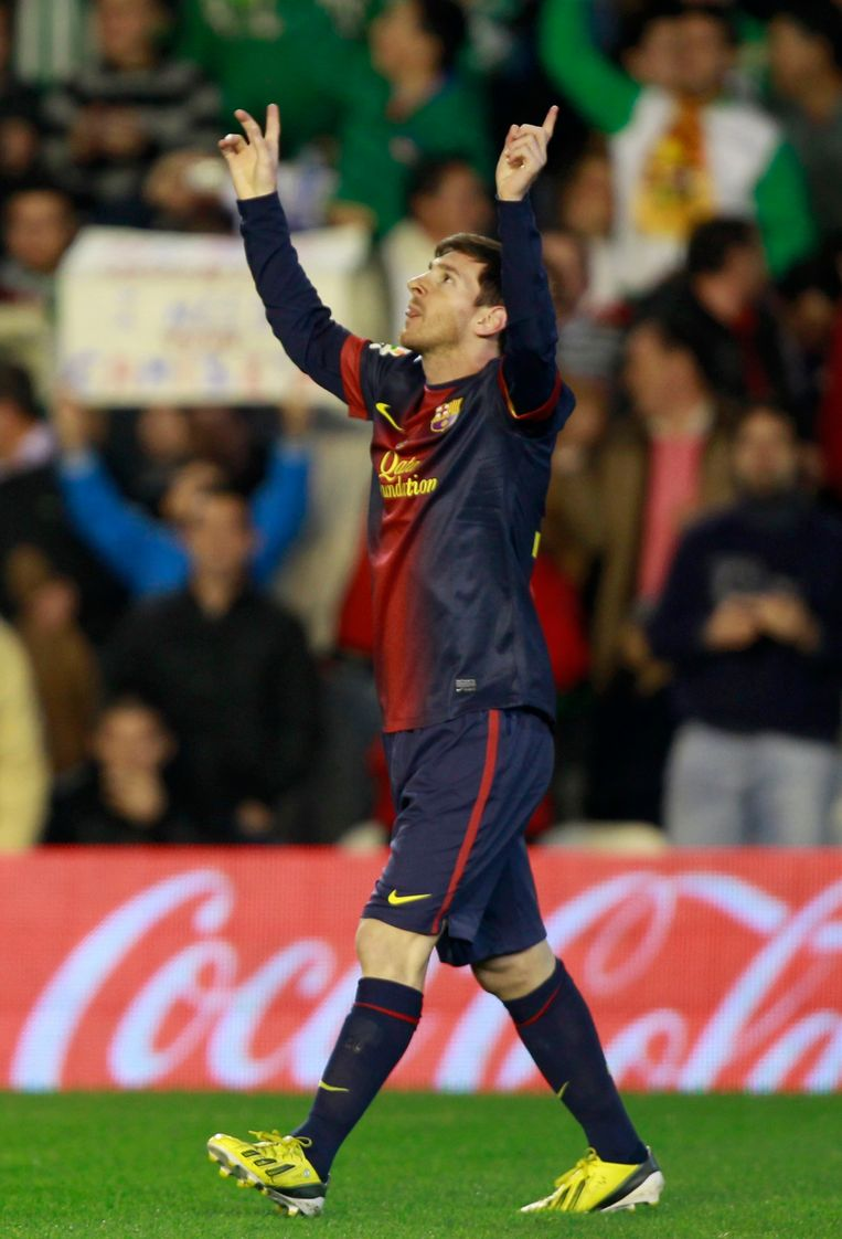 REFILE - PROVIDING FULL NAME OF LIONEL MESSI  Barcelona's Lionel Messi celebrates after scoring against Real Betis during their Spanish First Division soccer match at Benito Villamarin stadium in Seville December 9, 2012. REUTERS/Marcelo del Pozo (SPAIN - Tags: SPORT SOCCER) Beeld REUTERS
