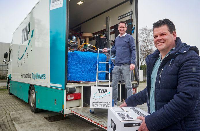 Het verhuis- en transportbedrijf Harrie van Erp Top Movers uit Oss bestaat 50 jaar. Ferenc van Liempde (achter) en Harm Broers vormen de huidige directie.
