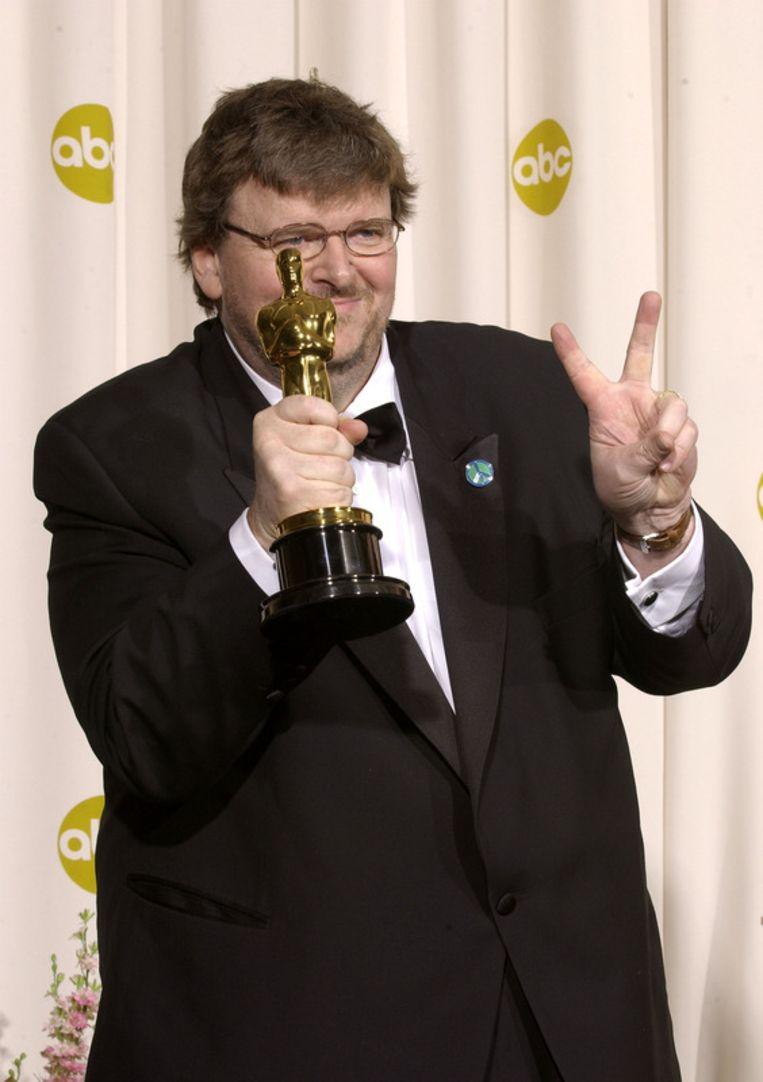 Michael Moore werd tijdens zijn speech door uit publiek uitgejouwd. Beeld UNKNOWN