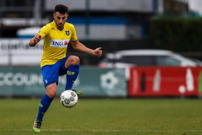 Oguzhan Kazanci in het shirt van Dongen .