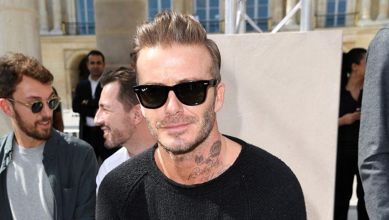 David Beckham op de runwayshow van Louis Vuitton Lente/Zomer 2017. Beeld Getty Images