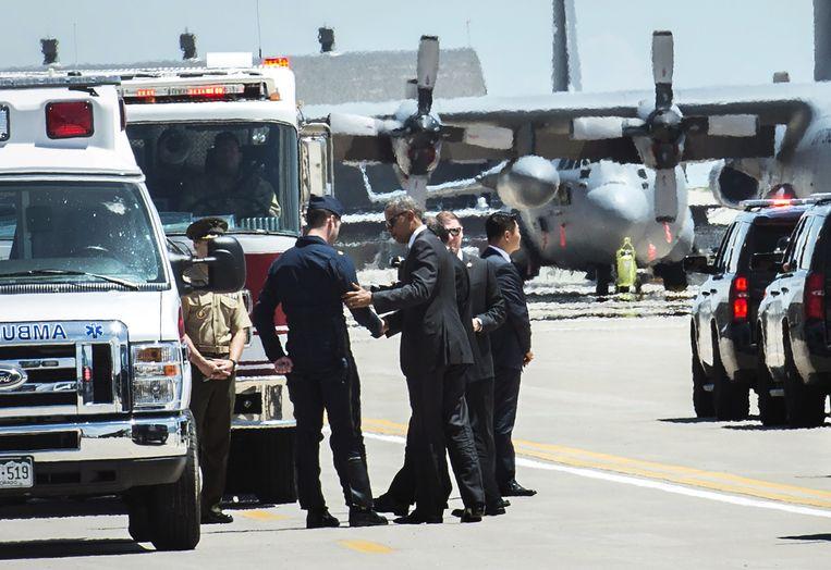 President Obama bij de lichtgewonde piloot in Colorado Springs Beeld AP