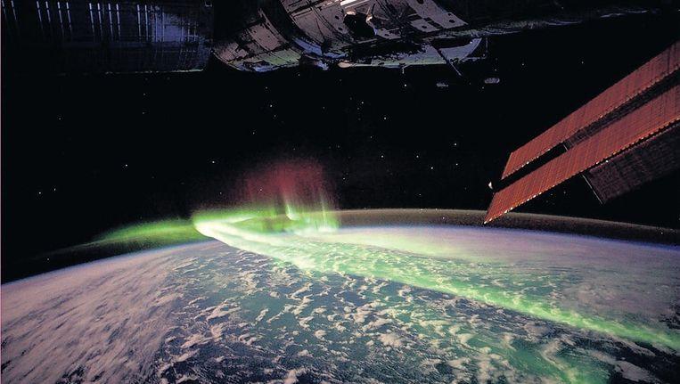 Het noorderlicht bezien vanuit de ruimte. Beeld AFP/NASA