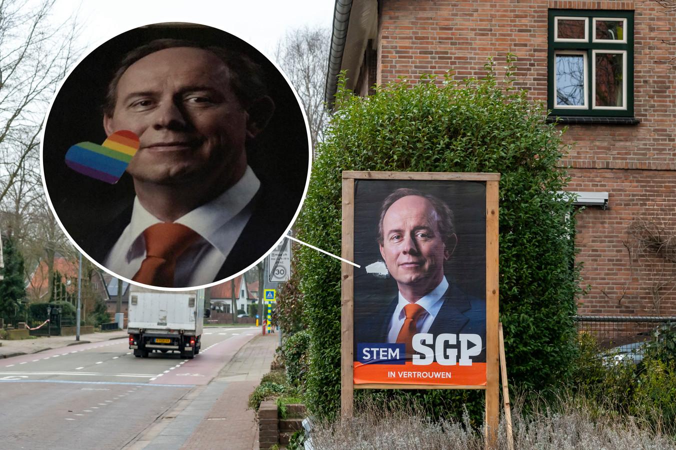 Op verkiezingsposters van SGP in Ermelo zijn regenbooghartjes geplakt, ook bij wethouder Leo van der Velden in de voortuin.