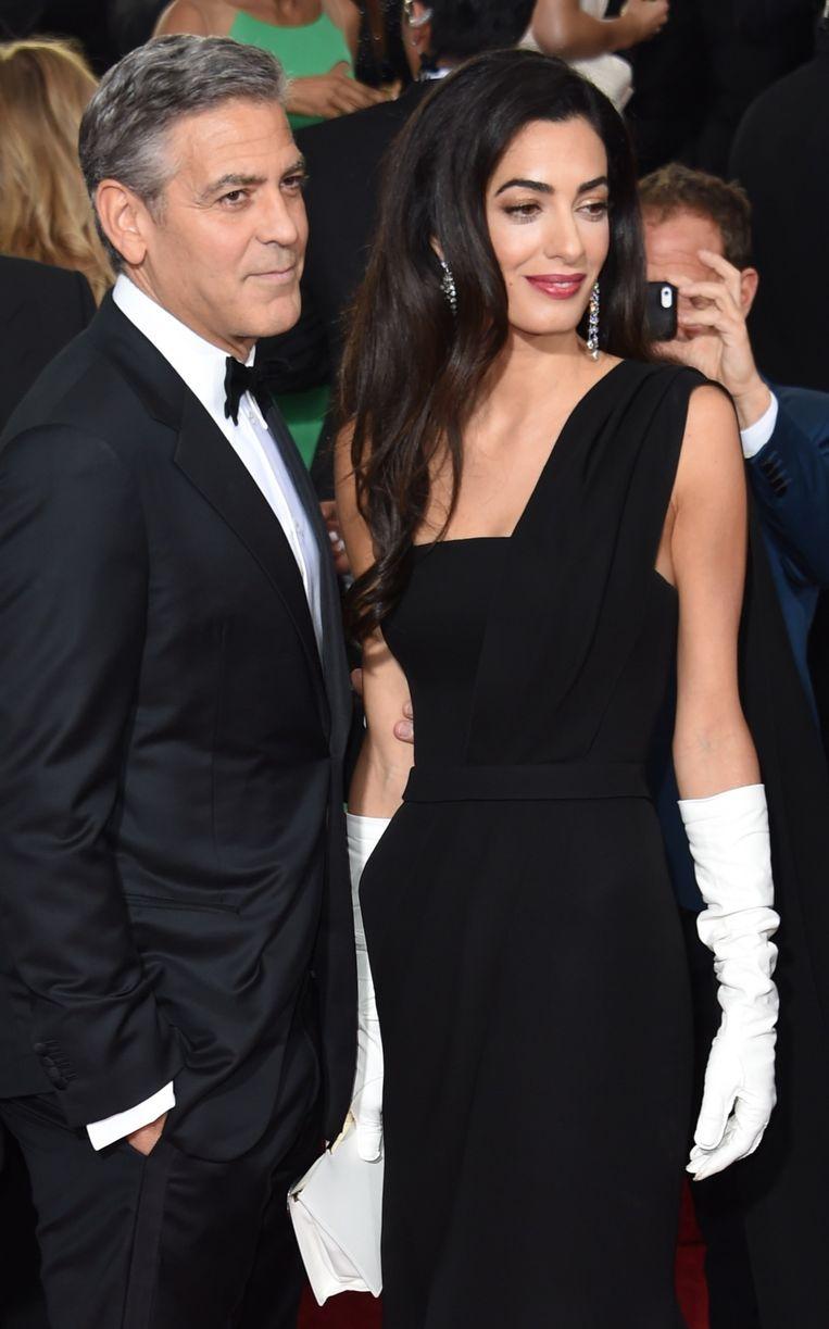 George en Amal Clooney. Beeld AFP