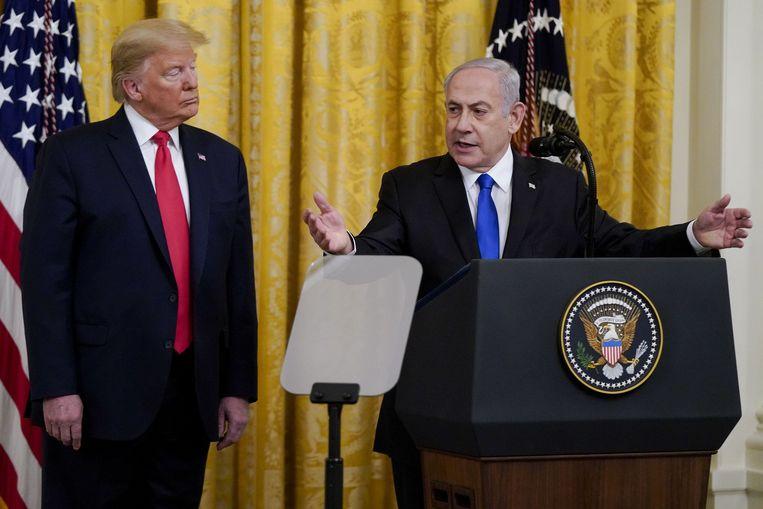 Israëlisch premier Benjamin Netanyahu en VS-president Donald Trump in het Witte Huis. Beeld Photo News