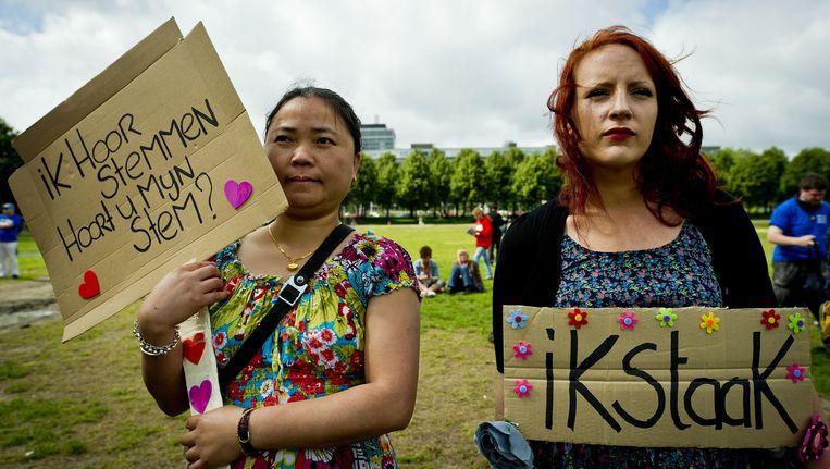 emonstranten op het Malieveld in Den Haag protesteren in 2011 tegen de bezuinigingen op de geestelijke gezondheidszorg. Beeld ANP