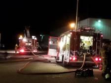 Brandweer blust accubrand in bedrijfspand Neede