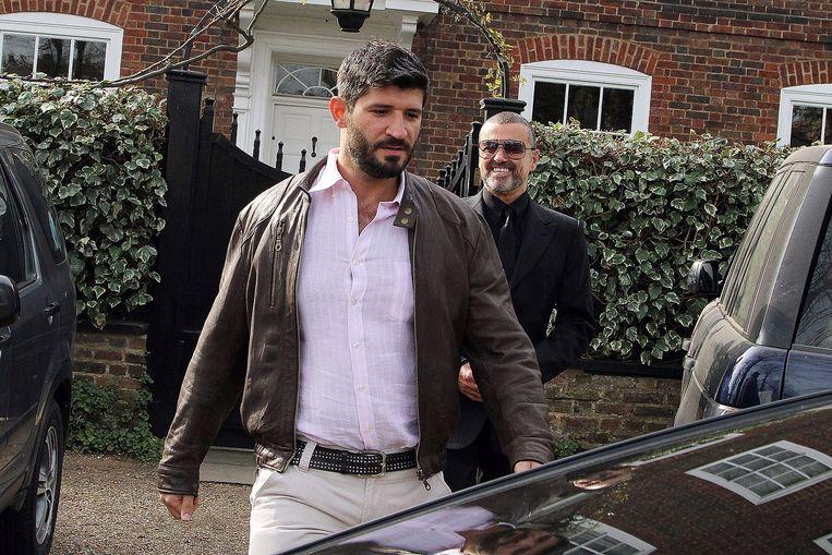 Fadi Fawaz krijgt noppes van zijn vriendje George Michael.  Beeld GC Images