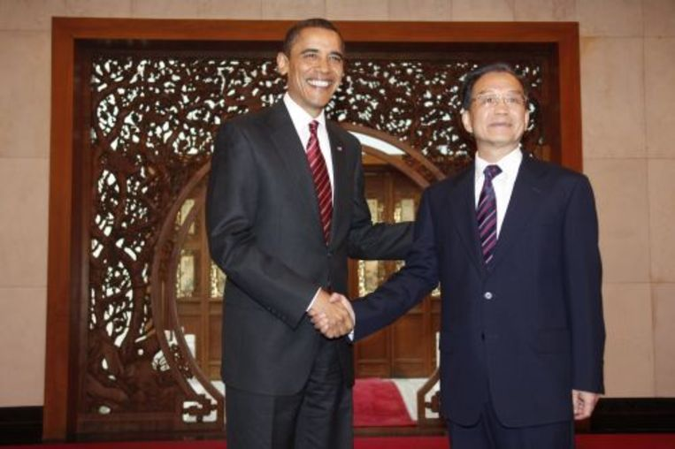 De Amerikaanse president Obama met met de Chinese pemier Wen Jiabao. ANP Beeld