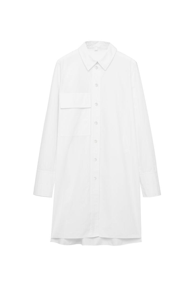 Lang wit overhemd met borstzakje van Cos, € 59. Beeld rv