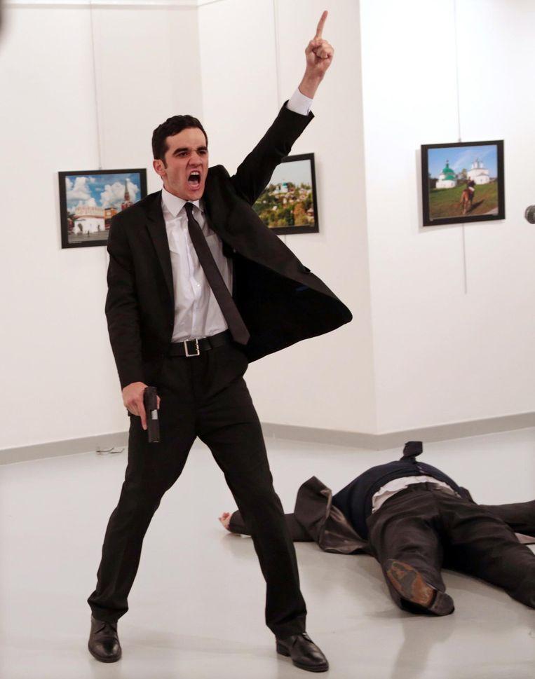 'Uiteindelijk vonden we dat het Beeld van het Jaar een explosieve afbeelding was die de haat van onze tijd het beste verbeeldt,' aldus het jurylid Mary F. Calvert Beeld Burhan Özbilici
