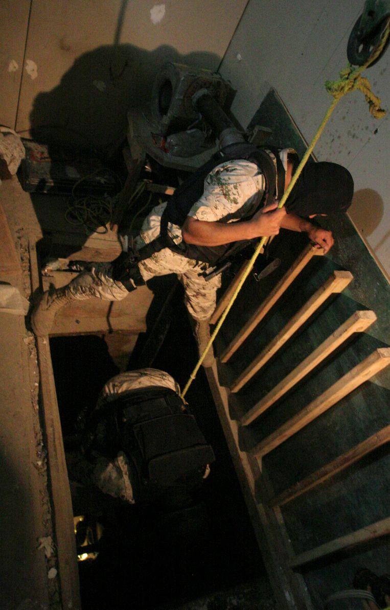 De ingang van een stokkeltunnel in Tijuana. Ontdekt in juli 2012. De tunnel is 350 meter lang en bevatte 50 ton aan marijuana. Beeld REUTERS