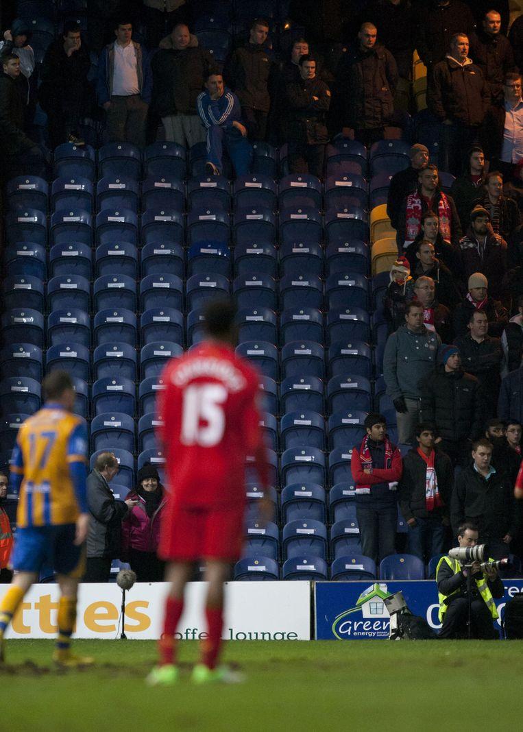 Liverpool hield 96 plaatsen onbezet ter nagedachtenis van Hillsborough. Beeld AP