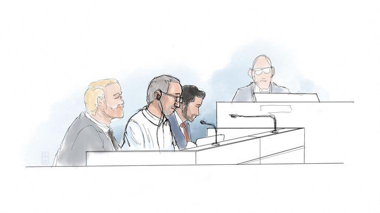 Hamid Noury (tweede van links) in de rechtszaal. Beeld AFP