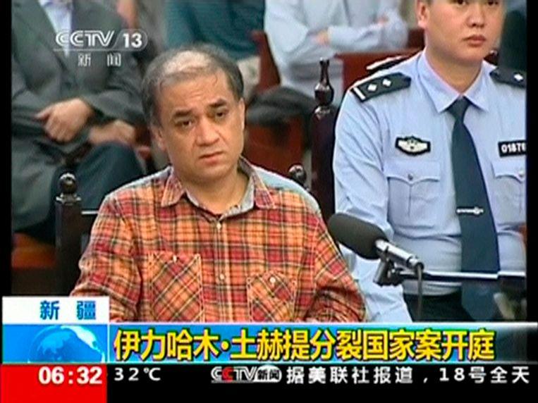 Oeigoerse denker en academicus Ilham Tohti tijdens zijn proces. Beeld REUTERS