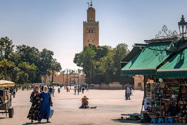 Mensen op straat in Marrakesh.  Beeld AFP