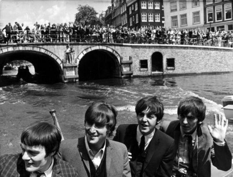 The Beatles tijdens een rondvaart in Amsterdam in 1964. ANP Beeld