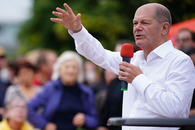 Olaf Scholz, lijsttrekker voor de sociaaldemocraten, tijdens een campagnebijeenkomst. Beeld EPA