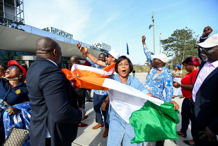 Aanhangers van Gbagbo reageren op zijn vrijspraak aan het Internationaal Strafhof in Den Haag. Beeld REUTERS