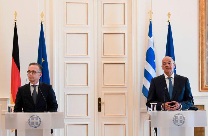 De Duitse minister van Buitenlandse Zaken Heiko Maas (l.) en zijn Griekse collega Nikos Dendias vanmiddag in Athene.