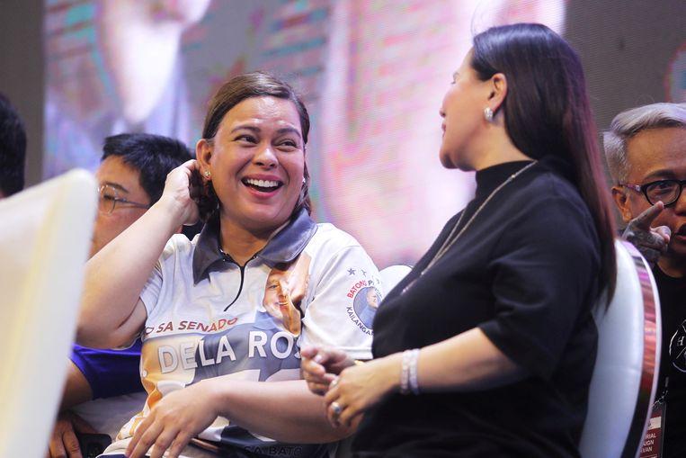 Sara Duterte (l). Beeld Reuters