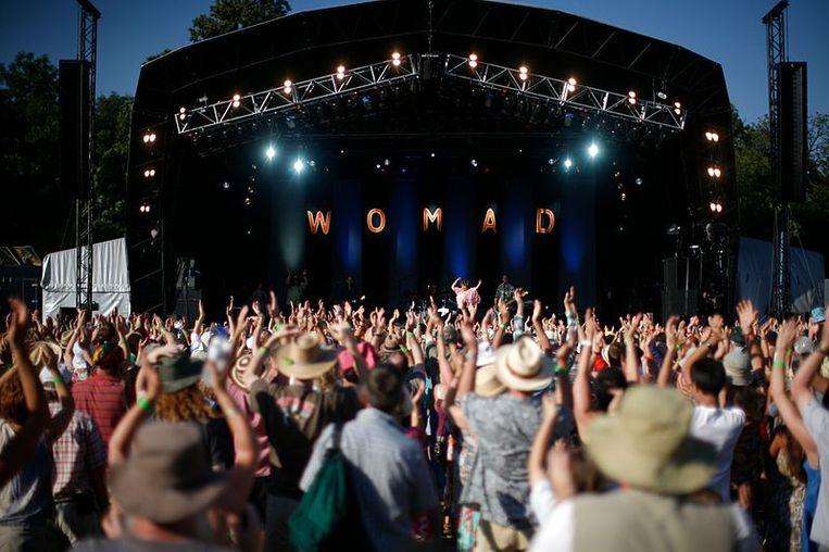 Een sfeerbeeld van een van de voorgaande edities van het Britse festival Womad. Beeld Wikimedia Commons/York Tillyer
