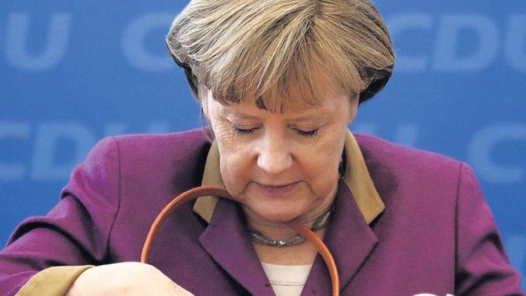 Angela Merkel. Volgens critici put ze haar ideeën niet uit christen-democratisch gedachtengoed. Beeld Reuters