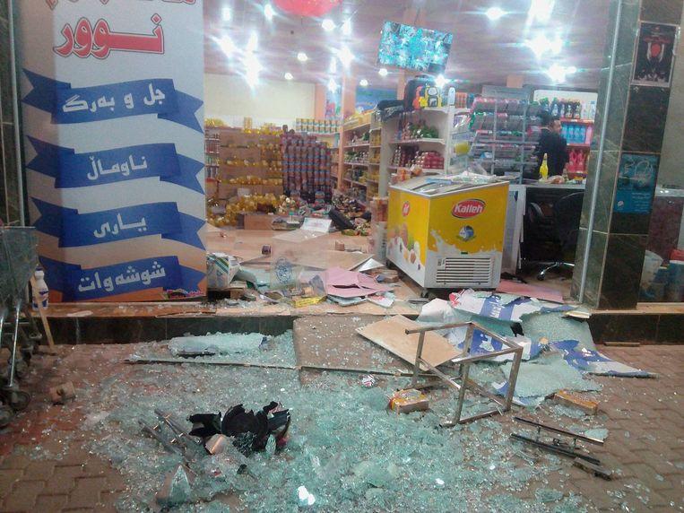 Een beschadigde winkel in Halabja in Irak. Beeld REUTERS