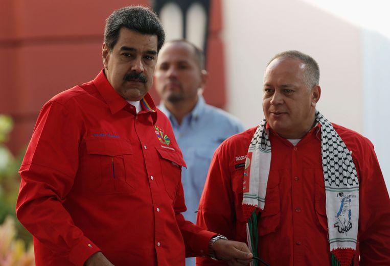 Venezolaans president Nicolás Maduro (links) en Diosdado Cabello, de nummer twee van Maduro's Verenigde Socialistische Partij van Venezuela.   Beeld Reuters