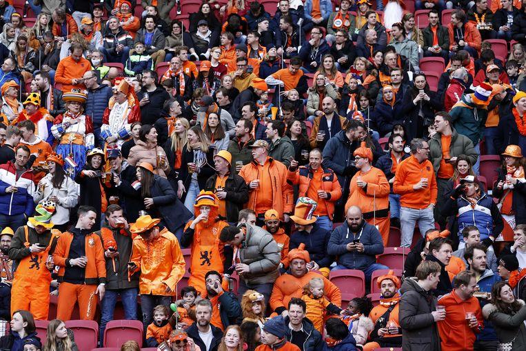 Supporters tijdens de WK-kwalificatie wedstrijd tussen Nederland en Letland in de Johan Cruijff Arena op 27 maart in Amsterdam, een van de testevents bij onze noorderburen.  Beeld ANP